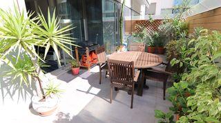 Appartamento in Carrer garraf, 18. Planta baja con terraza