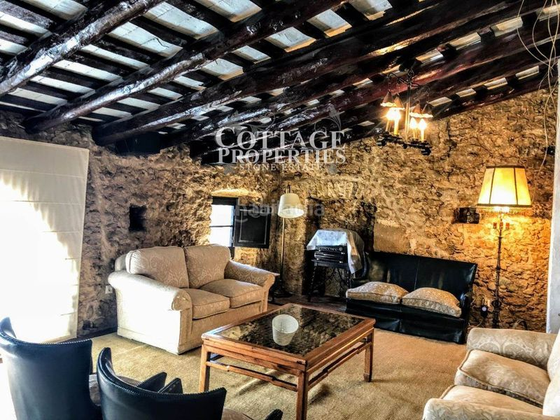 Salón. Country house with fireplace heating parking pool in Vilademuls