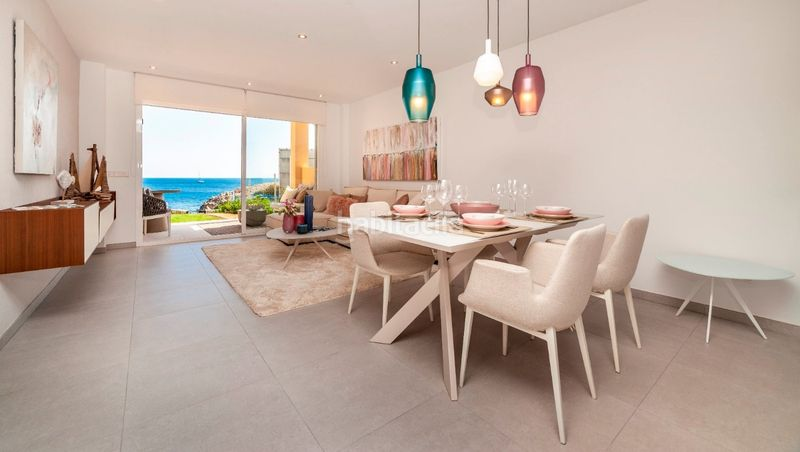 Salón comedor. Development Blue Cove, Cala Lliteras in Capdepera. Residential building of new buildings