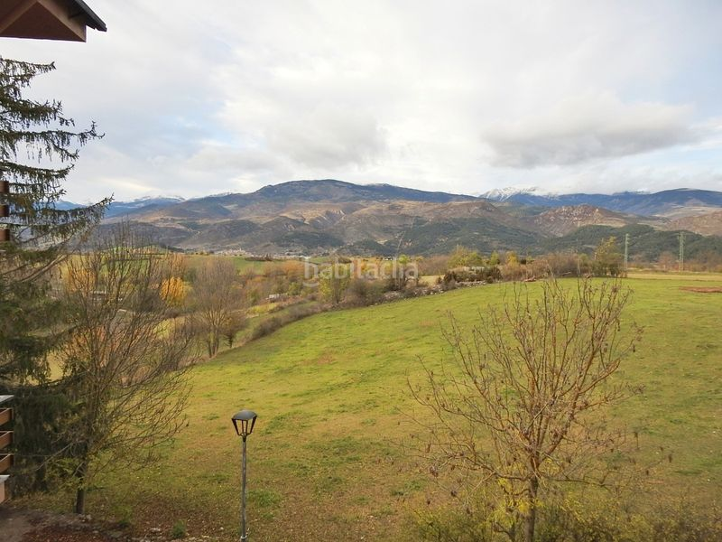 Vistes. Apartment with fireplace heating parking in Bellver de Cerdanya