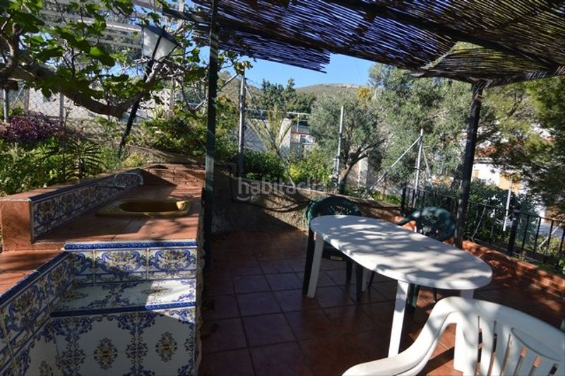 Terraza. Chalet with fireplace heating parking pool in Racó Cullera