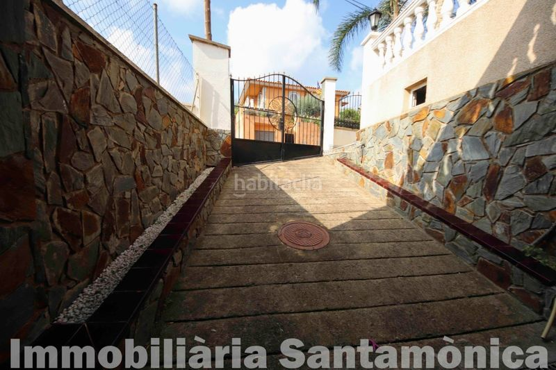 ACCESO GARAJE. House with fireplace heating parking in Can Moré-Santa Anna Pineda de Mar